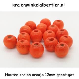Kraal gemaakt van hout rond oranje 12mm groot rijggat