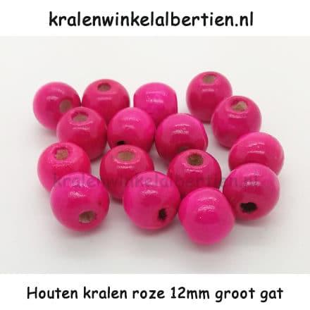 Kraal gemaakt van hout 12mm groot roze rond